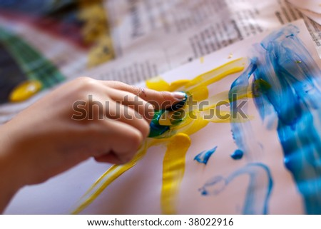 Little Children Hands doing Fingerpainting with various colors - stock photo