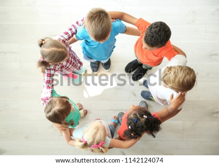 Little children making circle with hands around each other indoors, top view. Unity concept #1142124074