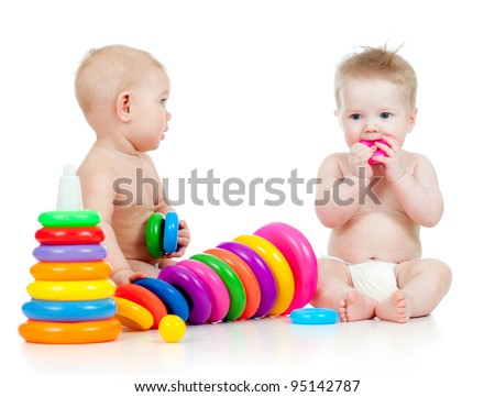 little children playing with color toys