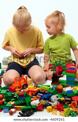 Little children playing with colorful cube blocks stock photo