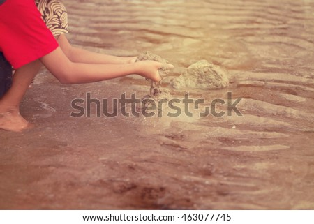 Little children playing with sand on the beach in the summer  #463077745
