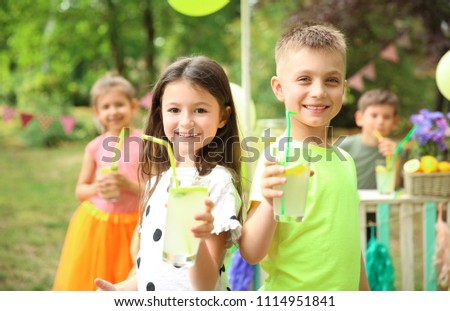 Little children with natural lemonade in park #1114951841