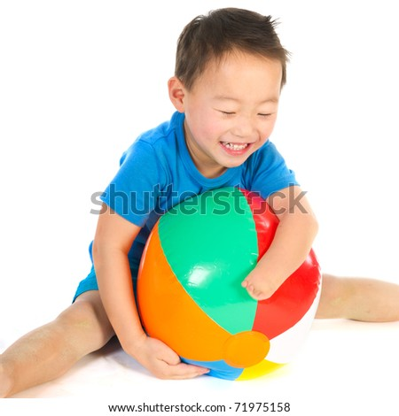 Little Chinese boys with light handicap hand playing with beach ball