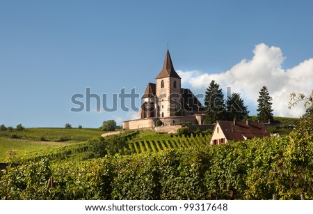 Little church of Hunawihr wine village in the middle of vineyards of Alsace, France