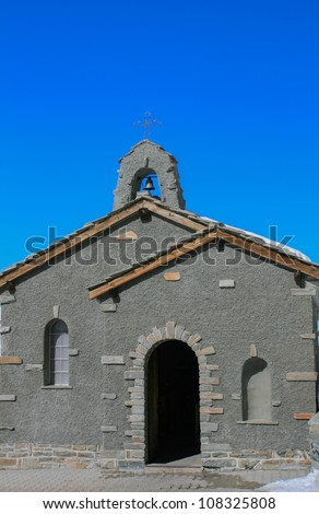 Little church with clear blue sky