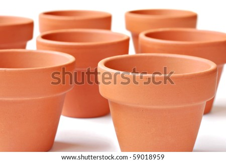 Little clay flower pots on white background.  Macro with shallow dof.