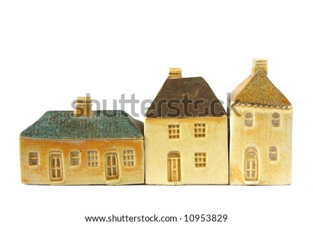 Little clay houses.  These are models of 19th century English houses, isolated on white.