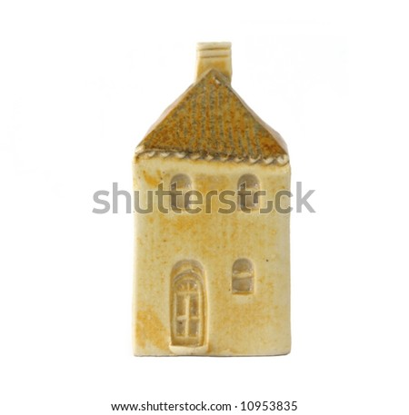 Little clay model house, isolated on white.