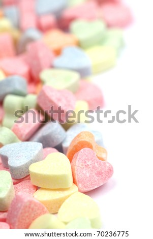 Little colorful candy hearts isolated on white background. Shallow dof