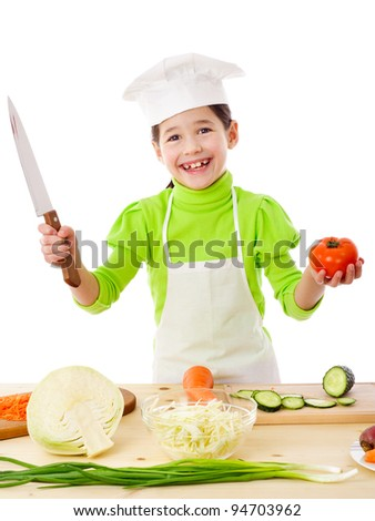 Little cook with knife and tomatoes in hands, isolated on white