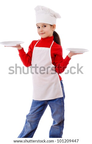Little cooker standing with two empty dishes, isolated on white