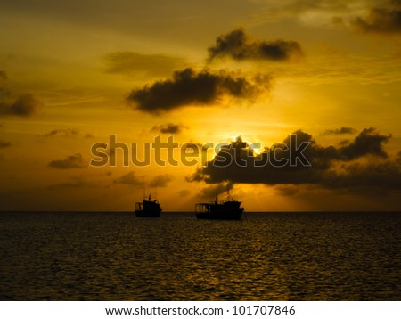 LITTLE CORN ISLAND, NICARAGUA: Silhouettes of fishing boats on the horizon at sunset