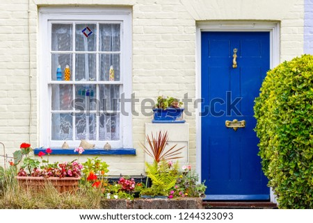 Little cottage with a blue door in Southwold, UK #1244323093