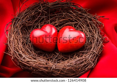 Little cozy nest with two red hearts. Valentine's day greetings concept - stock photo