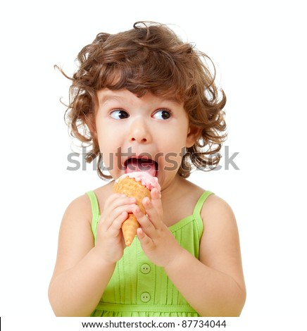 little curly girl with ice cream in studio isolated