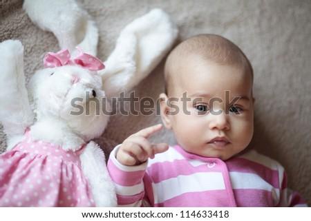 Little cute baby girl and rabbit mascot