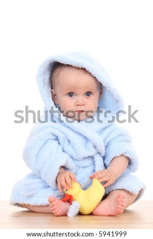 little cute baby girl in blue bathrobe isolated on white