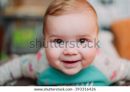 Stock Photo little cute baby toddler on carpet close up smiling adorable happy emotional playing at home