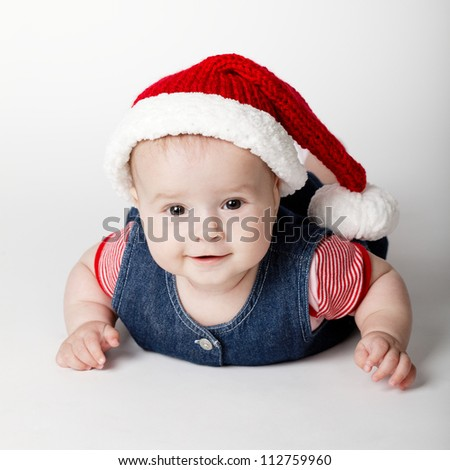 little cute baby with Santa costume