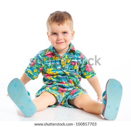 Little cute boy dressed in beach clothes and flip-flops. Isolated on white background.
