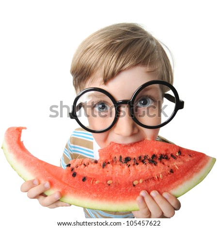 little cute boy eating a watermelon