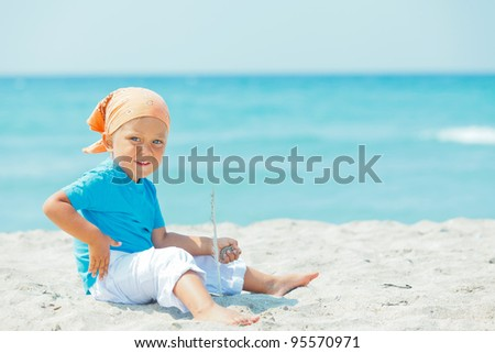 Little cute boy on the exotic white beach, Mallorca, Spain
