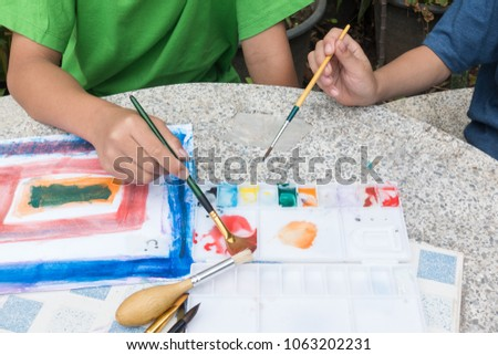 little cute boy painting with water color, lifestyle people concept #1063202231