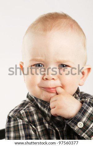 little cute boy with finger in mouth