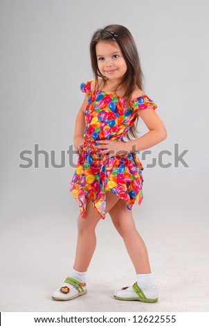 Baby Girl Fancy Dress on Little Cute Brown Haired Baby Girl Posing In Fancy Colored Short Dress