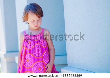Little cute child girl expressing sadness. Gestures, body language, facial expressions and  depression concept. Free space for text. #1332488369