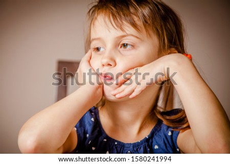 Little cute child girl expressing sadness. Gestures, body language, facial expressions and  depression concept.  #1580241994