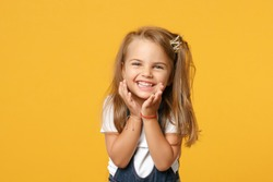 Little cute child kid baby girl 4-5 years old wears light denim clothes crown isolated on pastel yellow wall background children studio portrait. Mother's Day love family parenthood childhood concept