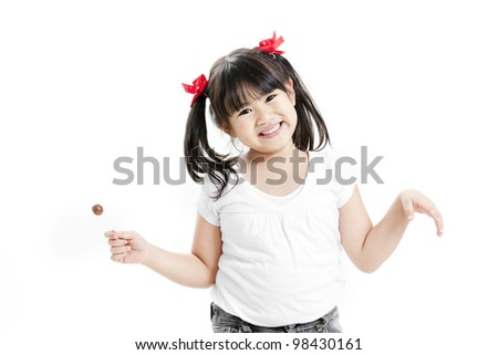 Little cute funny asian girl with colorful lollipop candy