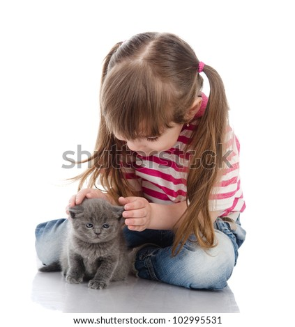 little cute girl affectionately hugging kitten.  isolated on white background