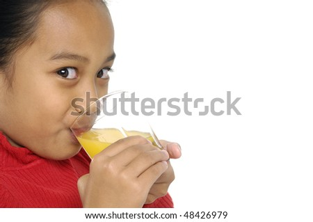 little cute girl drink orange juice for breakfast.