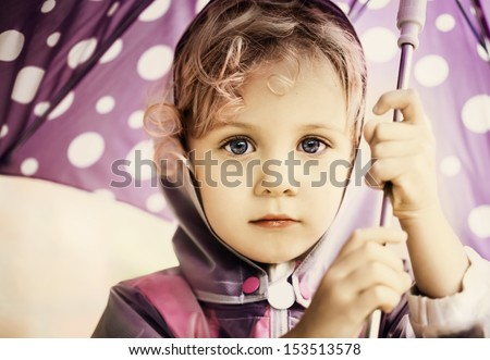 Little cute girl holding an umbrella close up portrait