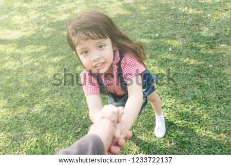 d7b5e920cba little cute girl holding hands parents looking at camera  1233722137