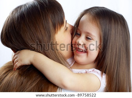 little cute girl hugging her mother's neck
