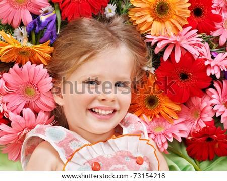 Little cute girl lying on the flower.