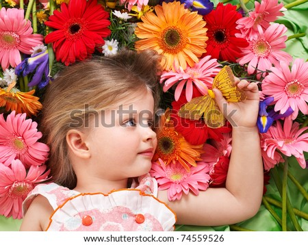 Little cute girl lying on the flower.