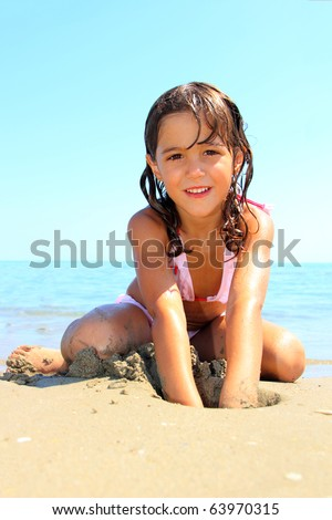 Little cute girl on the beach - stock photo