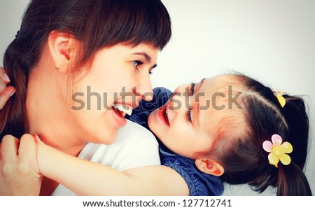little cute girl playing with her mother