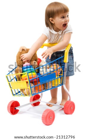 Little cute girl playing with toy shopping cart