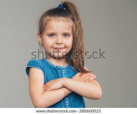 Little cute girl portrait cross hands
