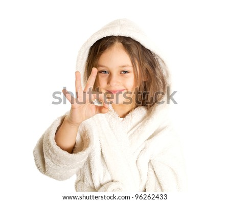 little cute girl shows gesture that all is well