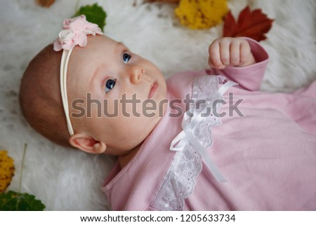 916017f3d7cf Free photos Adorable one-month-old baby girl lying in her bed ...