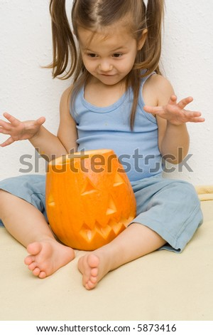 little, cute girl with a halloween lantern