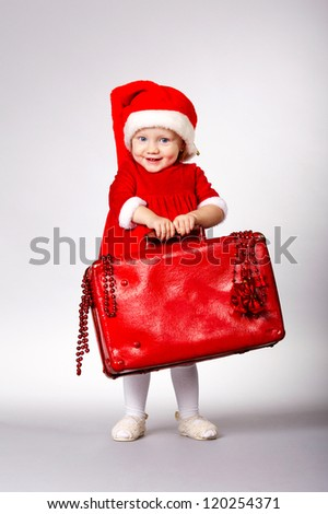 little cute girl with christmas suitcase