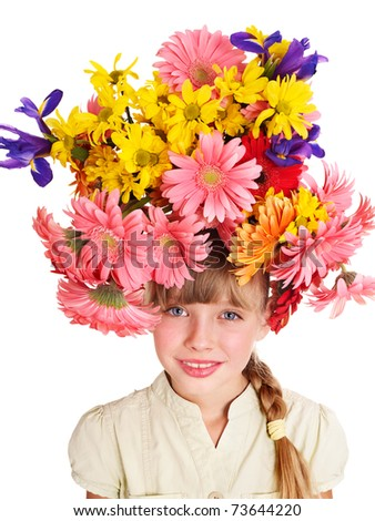 Little cute girl with flower wreath. Spring hairstyle.