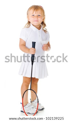 Little cute smiling girl holding a badminton racket on a white background